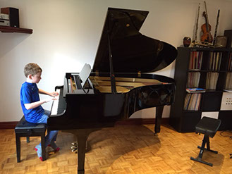 Pupil learning piano